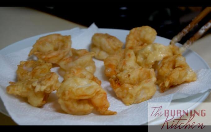 Crispy Wasabi Prawns: Remove excess oil using a kitchen towel