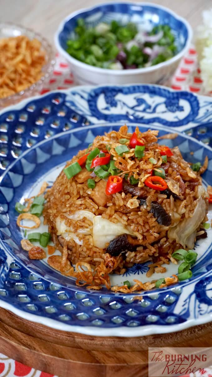Cantonese Cabbage and Mushroom Rice on a blue antique plate, topped with crispy shallots, spring onions and chilli