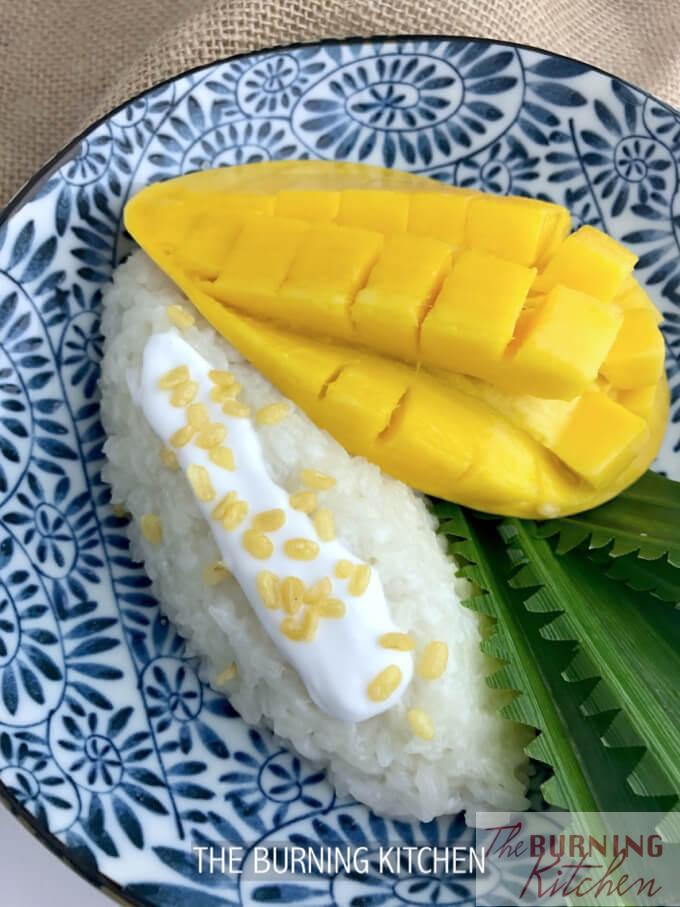 Thai Mango Sticky Rice (Khao Neow Ma Muang): This nationally acclaimed Thai dessert is made from this sweet glutinous rice steamed with coconut milk and topped with ripe mangoes, a sweet treat for any occasion!