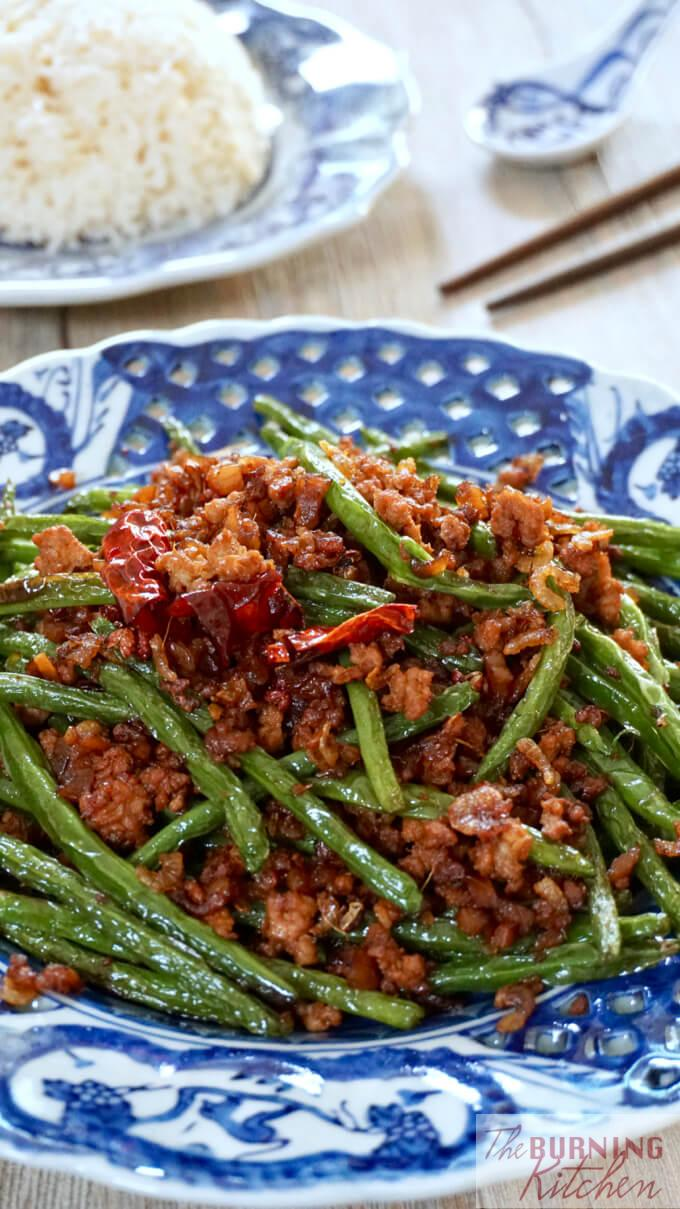 Szechuan Dry-Fried String Beans on a porcelain plate portrait